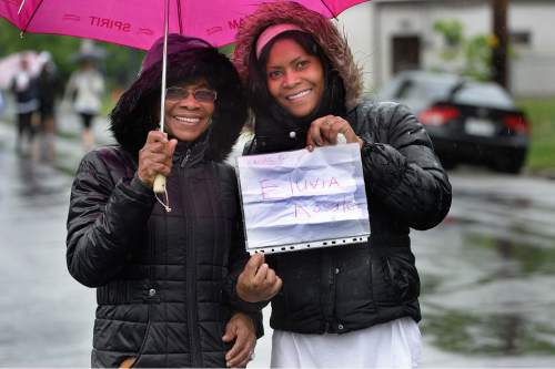 Scott Sommerdorf   |  The Salt Lake Tribune Salome Perkins, left, and her daughter Annette Campbell show that they are walking in remembrance of Eluvia Rosales at the 19th Annual Susan G. Komen Race for the Cure, Saturday, May 9, 2015.