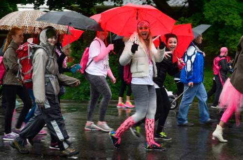Scott Sommerdorf   |  The Salt Lake Tribune The 19th Annual Susan G. Komen Race for the Cure heads for Library Square during a steady rainstorm, Saturday, May 9, 2015.