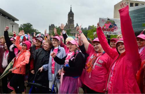 Scott Sommerdorf   |  The Salt Lake Tribune Survivors celebrate after a shortened Survivors Parade at the 19th Annual Susan G. Komen Race for the Cure, Saturday, May 9, 2015. A dove release was planned, but canceled due to the rainy weather.