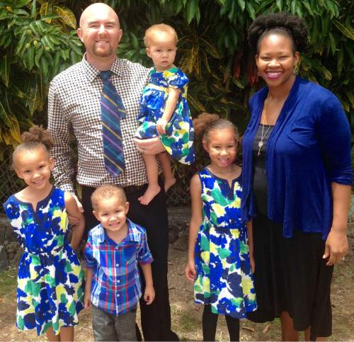 (Courtesy  |  Brian Dawson)  Mormon Sunday school teacher Brian Dawson with his children and his wife, Ezinne Dawson.