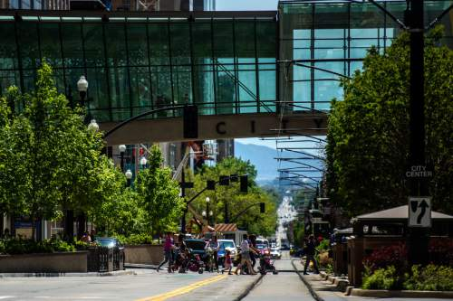 Chris Detrick  |  The Salt Lake Tribune Pedestrians walk across Main Street by City Creek Center Wednesday April 29, 2015.