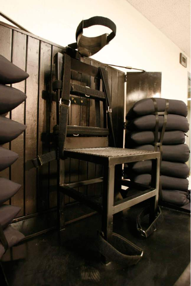 Trent Nelson  |  Tribune file photo The execution chamber at the Utah State Prison in Draper after Ronnie Lee Gardner was executed by firing squad Friday, June 18, 2010. Four bullet holes are visible in the wood panel behind the chair. Gardner was convicted of aggravated murder, a capital felony, in 1985.