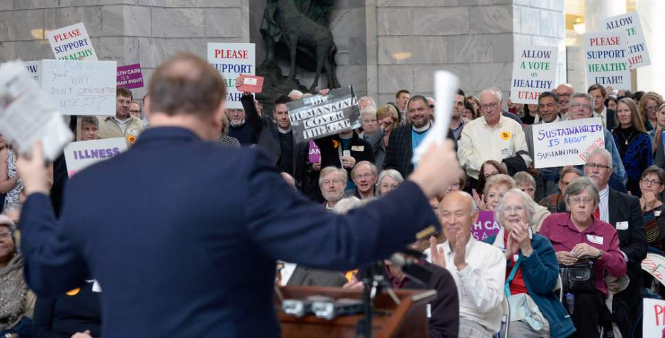 Al Hartmann  |  The Salt Lake Tribune  Sen. Jim Dabakis, D-Salt Lake, in foreground, stirs the crowd up at The Utah Health Policy Project, as hundreds of citizens and advocates of the governor's plan to expand Medicaid, Healthy Utah rally at noon Thursday March 5, 2015, inside the Capitol rotunda.