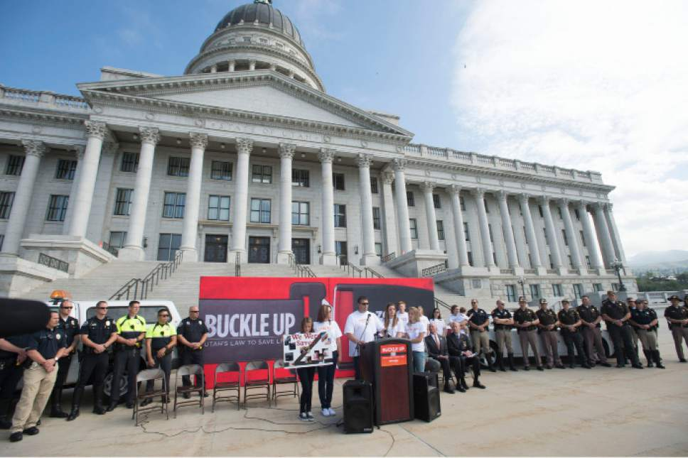 Steve Griffin  |  The Salt Lake Tribune  The Barney family, of South Jordan, Utah, who survived a car crash because they were all wearing seat belts is joined by Utah Highway Patrol troopers, Salt Lake City police officers, legislators and UDOT officials during an event promoting the new law that makes it easier to enforce seat belt requirements. The law takes effect Tuesday. The event was held at the Utah State Capitol in Salt Lake City, Thursday, May 7, 2015.