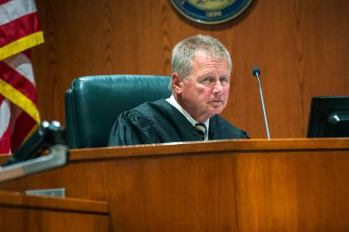 Chris Detrick  |  The Salt Lake Tribune Second District Judge David Hamilton during Aza Vidinhar's sentencing in 2nd District Court at the Davis Justice Complex in Farmington Wednesday May 13, 2015. Aza Ray Vidinhar pleaded guilty in June, admitting that he fatally stabbed 10-year-old Alexander Vidinhar and 4-year-old Benjie Vidinhar in May 2013. Vidinhar was sentenced Wednesday to 15 years to life in prison.