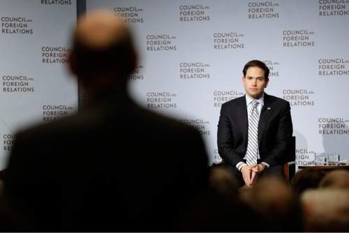 Republican presidential hopeful Sen. Marco Rubio, R-Fla., takes a question from an audience member while speaking at the Council on Foreign Relations, Wednesday, May 13, 2015, in New York. Rubio called for increasing military spending and for the U.S. to aggressively confront Russia, China and others that he says threaten the nation's economic interests. (AP Photo/Mary Altaffer)