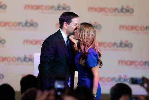 Florida Sen. Marco Rubio kisses his wife Jeanette after he announced that he will be running for the Republican presidential nomination, during a rally at the Freedom Tower, Monday, April 13, 2015, in Miami. (AP Photo/Wilfredo Lee)