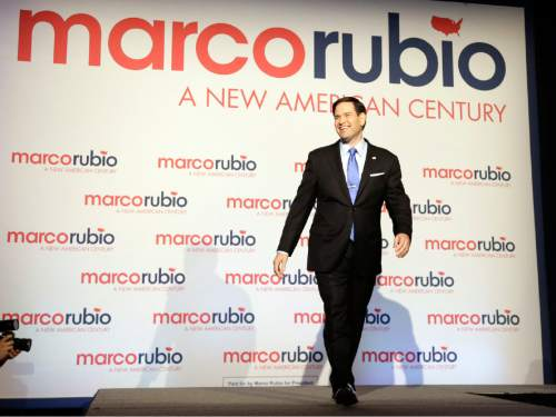 Florida Sen. Marco Rubio smiles as he arrives before announcing he is running for the Republican nomination, at a rally at the Freedom Tower, Monday, April 13, 2015, in Miami. (AP Photo/Alan Diaz)