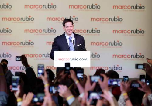 Florida Sen. Marco Rubio smiles as he looks out at supporters as he announces that he is running for the Republican presidential nomination, during a rally at the Freedom Tower, Monday, April 13, 2015, in Miami. (AP Photo/Wilfredo Lee)