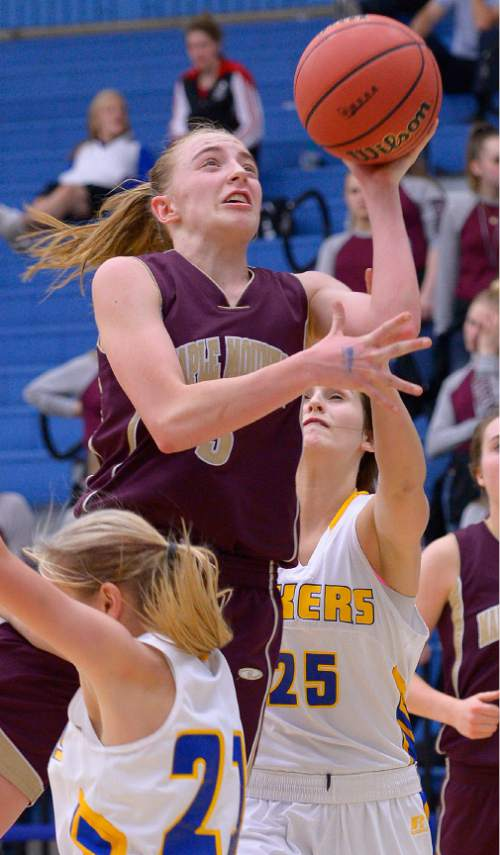 Leah Hogsten  |  The Salt Lake Tribune Maple Mountain's Liz Eaton drives to the net. Maple Mountain High School girls basketball team defeated Bonneville High School 55-44 during the 4A State Championships first round game, Tuesday, February 17, 2015 at Salt Lake Community College's Lifetime Activities Center .