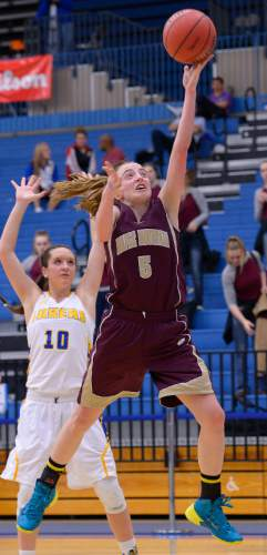 Leah Hogsten  |  The Salt Lake Tribune Maple Mountain's Liz Eaton hits the rim.  Maple Mountain High School girls basketball team defeated Bonneville High School 55-44 during the 4A State Championships first round game, Tuesday, February 17, 2015 at Salt Lake Community College's Lifetime Activities Center .
