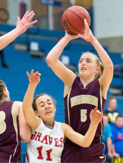 Rick Egan  |  The Salt Lake Tribune  Liz Eaton (5), Maple Mountain, shoots over Sophia Skedros (11), Bountiful, in 4A State Girls Basketball Tournament action, Bountiful vs Maple Mountain, Thursday, February 19, 2015.