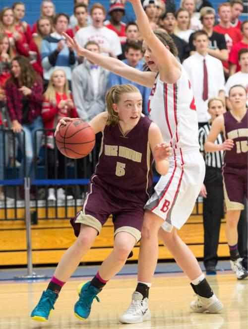 Rick Egan  |  The Salt Lake Tribune  Liz Eaton (5), Maple Mountain, tries to get past Kennedy Redding, Bountiful, in 4A State Girls Basketball Tournament action, Bountiful vs Maple Mountain, Thursday, February 19, 2015.