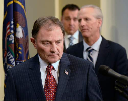 Al Hartmann  |  The Salt Lake Tribune  Gov. Gary Herbert enters room followed by Senate President Wayne Niedehauser and Speaker of the House Gregory Hughes where he announced a joint resolution to be passed in the legislature to get a Medicaid, Healthy Utah bill done by Summer 2015.  A committee of senate and house leadership,  the original bill sponsors and the Lt. governor will work together to come up with an agreement.