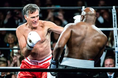 Chris Detrick  |  The Salt Lake Tribune Mitt Romney and Evander Holyfield box at the Rail Event Center Friday May 15, 2015.  Holyfield won after Romney threw in the towel after two rounds. Friday's Romney-Holyfield showdown raised over $1 million for CharityVision, a 20-year-old nonprofit dedicated to saving the eyesight of impoverished people in developing nations.