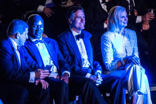 Chris Detrick  |  The Salt Lake Tribune Mitt Romney, Ann Romney and Evander Holyfield watch the boxing matches at the Rail Event Center Friday May 15, 2015. Friday's Romney-Holyfield showdown will raise about $1 million for CharityVision, a 20-year-old nonprofit dedicated to saving the eyesight of impoverished people in developing nations.