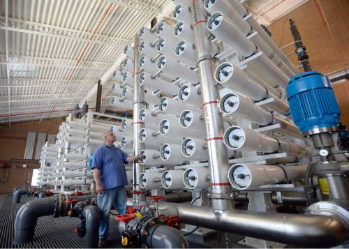 Al Hartmann |  The Salt Lake Tribune Lead operator Mike Axelgard works on Jordan Valley Water Conservancy District's reverse osmosis Southwest Groundwater Treatment Plant Wednesday May 13, 2015. It's reaching its final phase to clean up a plume contaminated by historic mining activities at Bingham Canyon. The Southwest Groundwater Treatment Plant uses reverse osmosis to produce 4,500 acre feet of clean drinking water a year. Now the district is seeking final permission to pipe 1.5 million gallons of selenium-laced byproduct water in the Great Salt Lake.