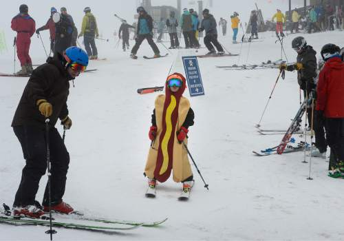 Scott Sommerdorf      The Salt Lake Tribune Quinn Steffen, 8, and his Dad Jim, left, enjoy the foggy day at Alta, Sunday, April 25, 2015. For only the second time in the last 50 years, Alta Ski Area has not reached a 100-inch base.