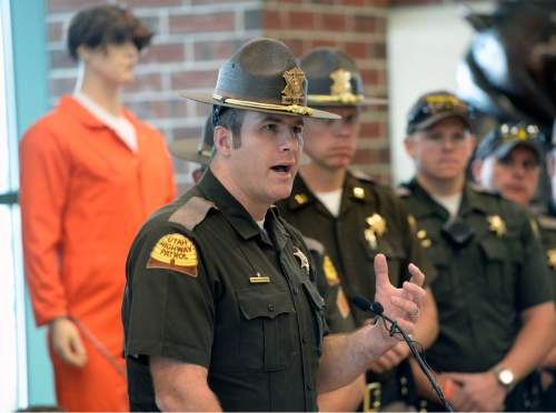 Al Hartmann    The Salt Lake Tribune UHP Trooper/spokesman Lawrence Hopper speaks at a Memorial Day DUI prevention press conference at Scheels All Sports in Sandy on Thursday, May 21, 2015. At the store's entrance is a 20-foot exhibit, titled ìUtahís Deadliest Predators,î which features Utahís top seven predators. The deadliest is the drunk driver, who kills an average of 30 people per year.