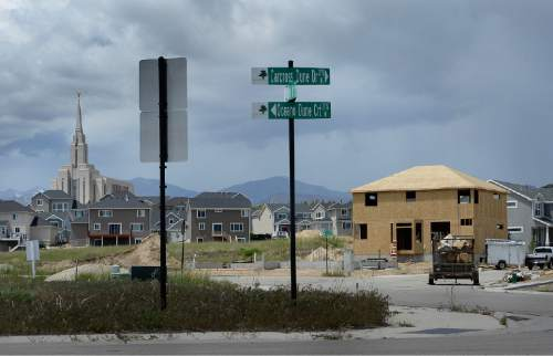 Scott Sommerdorf   |  The Salt Lake Tribune Housing development is underway near South Kelso Dune Drive, and within sight of the Oquirrh Temple in South Jordan, Wednesday, May 20, 2015.  South Jordan has beat out Taylorsville as Utah's 10th most populous city, after Taylorsville held the 10th spot for the prior four years.