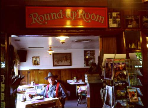 (Courtesy J. Sharee Jones)  Dick's Cafe patron in the Round-Up Room, circa 1999.
