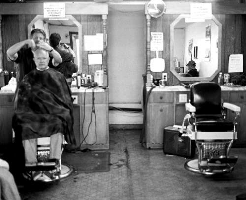 (Courtesy J. Sharee Jones)  Barber Art Hale working in his shop in Dick's Cafe, circa 1999, with an empty barber's station representing Ron Knell, with whom Hale apprenticed for years.