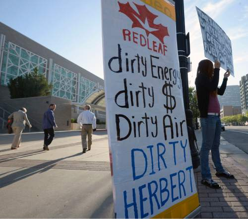 Al Hartmann |  The Salt Lake Tribune Peaceful Uprising and members of Utah Tar Sands Resistance protest on the south side of the Salt Palace Convention Center and greet conference goers to the Governor's Energy Development Summit Thursday May 21, 2015.