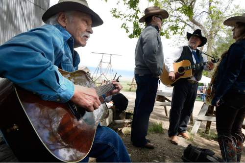 "Scott Sommerdorf   |  The Salt Lake Tribune Jay ""Bo"" Dean from Helena, Montana, plays his guitar at the Cowboy Legends Cowboy Poetry and Music Festival at the Fielding-Garr Ranch on Antelope Island, Saturday, May 23, 2015."