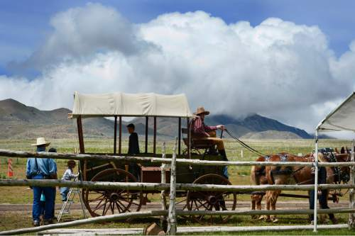 Scott Sommerdorf   |  The Salt Lake Tribune A covered wagon loads up its young customers for a ride at the Cowboy Legends Cowboy Poetry and Music Festival at the Fielding-Garr Ranch on Antelope Island on Saturday.
