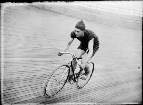 "Courtesy  |  Charles A. Maccarthy Collection, Special Collections Department, Stewart Library, Weber State University  In the 1890s, bicycle racing was a popular pastime in Utah and across the country. Here, an Ogden ìwheelmanî races at a local track known as the ""Saucer,"" located at the present-day site of Lorin Farr Park."