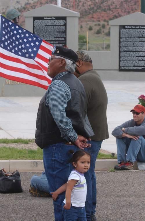 Vietnam veteran Bryant Jake brought 18-month-old granddaughter Echo Marie Hummingbird Jake to dedication of World War II memorial Saturday in Cedar City. Mark Havnes/The Salt Lake Tribune
