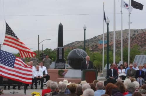 Cedar City Mayor Gerald Sherratt speaks to crowd Saturday at the dedication of World War II memorial in the southern Utah city. Mark Havnes/The Salt Lake Tribune