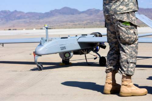 AAl Hartmann  |  The Salt Lake Tribune Aircraft of the Unmanned System Integration Capability (MUSIC) was demonstrated at Dugway Proving Grounds Thursday Sepetmeber 15.   Soldier's boots give scale to the size of the Shadow .