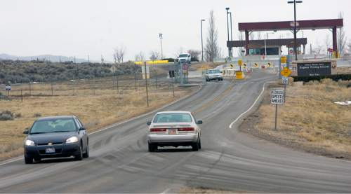 Al Hartmann  |  Tribune file photo  Cars go through the front gate at Dugway Proving Ground.