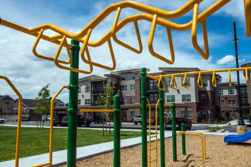 Chris Detrick  |  The Salt Lake Tribune The playground and exterior of housing units at Canyon Crossing at Riverwalk Wednesday May 27, 2015.  Canyon Crossing at Riverwalk is a newly constructed 10-building affordable housing community in Midvale.  The $36 million development creates 180 apartments for low-income families in the area and was made possible through a $13 million Low-Income Housing Tax Credit investment by American Express syndicated by Enterprise Community Investment.