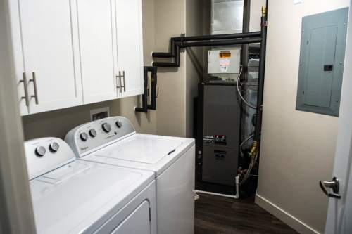 Chris Detrick  |  The Salt Lake Tribune The interior of a three-bedroom housing unit at Canyon Crossing at Riverwalk Wednesday May 27, 2015.  Canyon Crossing at Riverwalk is a newly constructed 10-building affordable housing community in Midvale.  The $36 million development creates 180 apartments for low-income families in the area and was made possible through a $13 million Low-Income Housing Tax Credit investment by American Express syndicated by Enterprise Community Investment.