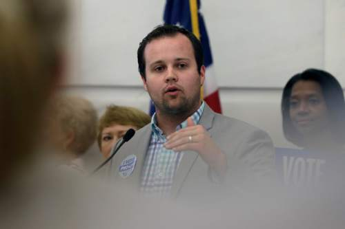 FILE - In this Aug. 29, 2014, file photo, Josh Duggar, executive director of FRC Action, speaks in favor the Pain-Capable Unborn Child Protection Act at the Arkansas state Capitol in Little Rock, Ark. Tony Perkins, president of the Washington-based Christian lobbying group, said Thursday, May 21, 2015, that he has accepted the resignation of Duggar in the wake of the reality TV star's apology for unspecified bad behavior as a young teen. (AP Photo/Danny Johnston, File)