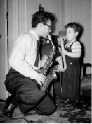 Steve Williams, host of KUER's nighttime jazz programming, as a child with his father, jazz musician Murray Williams. Courtesy KUER
