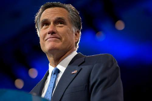 FILE - This March 15, 2013 file photo shows former Massachusetts Gov., and 2012 Republican presidential candidate, Mitt Romney at the 40th annual Conservative Political Action Conference in National Harbor, Md.  MSNBC host Melissa Harris-Perry is apologizing to Mitt Romney's family after a picture of the Romney holiday card that showed the 2012 Republican presidential candidate's adopted, African-American grandson was joked about on her show. (AP Photo/Jacquelyn Martin, File)