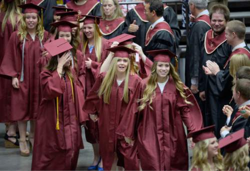 Al Hartmann |  The Salt Lake Tribune The largest senior graduating class of Lone Peak High School shows expressions of joy and relief marching in procession into the UCUU Events Center Thursday May 28, 2015, for commencment.
