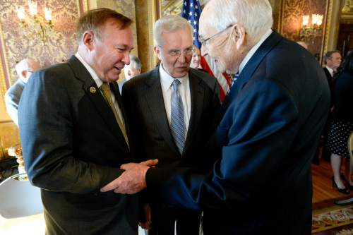Francisco Kjolseth     The Salt Lake Tribune  Sen. Jim Dabakis, D-Salt Lake, left, greets top Mormon leaders, including apostle D. Todd Christofferson, center, and L. Tom Perry, second in line for the LDS Church's presidency, as they appear at a news conference at the Capitol to publicly endorse nondiscrimination bill SB296.