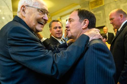 Chris Detrick     The Salt Lake Tribune Gov. Gary R. Herbert gives L. Tom Perry, Quorum of the Twelve Apostles, his ceremonial pen used to sign SB296 at the Utah State Capitol Thursday March 12, 2015.