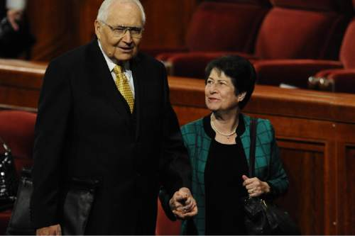 Courtesy     LDS Newsroom  Elder L. Tom Perry leaves the October 2010 General Conference with his wife, Barbara.