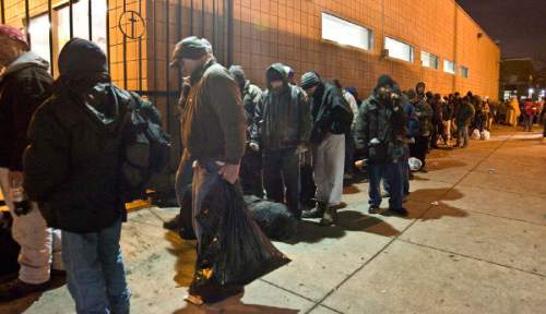 Paul Fraughton  |  Tribune file photo Men stand in line in 2008 at the Road Home  shelter on Rio Grande Avenue.