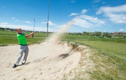 Rick Egan  |  The Salt Lake Tribune  Troy DeLuca chips out of a sand trap at Mulligans, Monday, June 1, 2015.