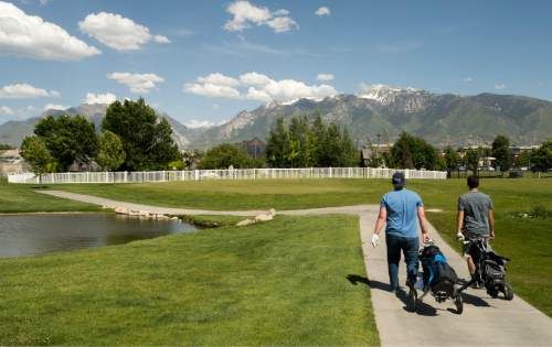 Rick Egan  |  The Salt Lake Tribune  David Nielson and Bronson Schroeder head to the clubhouse after playing golf at Mulligans, Monday, June 1, 2015.