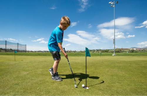 Rick Egan  |  The Salt Lake Tribune   Hunter Thomas, 10, practices his putting at Mulligans, Monday, June 1, 2015.