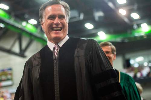 Chris Detrick  |  The Salt Lake Tribune Mitt Romney smiles as he walks during Utah Valley University's Commencement Ceremonies at the UCCU Events Center Thursday April 30, 2015.