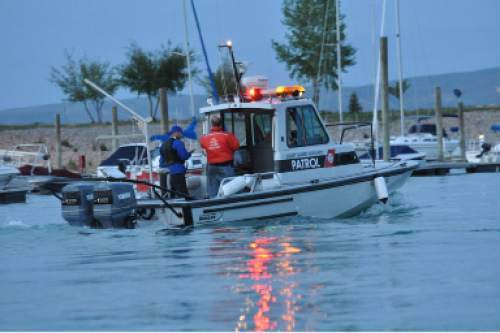 (Photo courtesy Tammy Calder via KUTV)  Rescuers conduct a search on Bear Lake to look for a capsized boat. Four people, including three children, were killed in the accident on Monday, June 1, 2015.