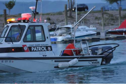 (Photo courtesy Tammy Calder via KUTV)  Rescuers conduct a search on Bear Lake to look for a capsized boat. Four people, including three children, were killed in the accident on Monday, June 1, 2015..